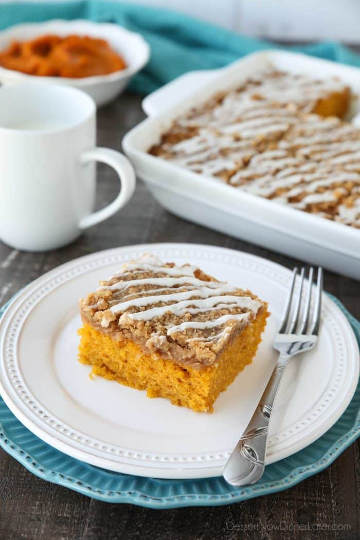 Pumpkin Spice Coffee Cake is easy to make and full of real pumpkin and fragrant spices. It's moist, yet light and fluffy, with a cinnamon crumb topping and pumpkin spice icing drizzled on top.
