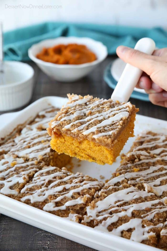 Pumpkin Spice Coffee Cake is easy to make and full of real pumpkin. It's moist, yet light and fluffy, with a cinnamon crumb topping and pumpkin spice icing drizzle on top.