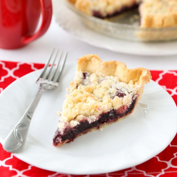 Cherry Crumb Pie can be made with fresh or frozen cherries, flavored with a hint of almond extract, and topped with a sweet crumble topping. Easy and delicious!