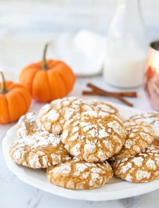 Pumpkin Crinkle Cookies are light, soft, and cake-like with warm, flavorful pumpkin spices. You'll love this easy fall cookie coated in powdered sugar that cracks as it bakes.