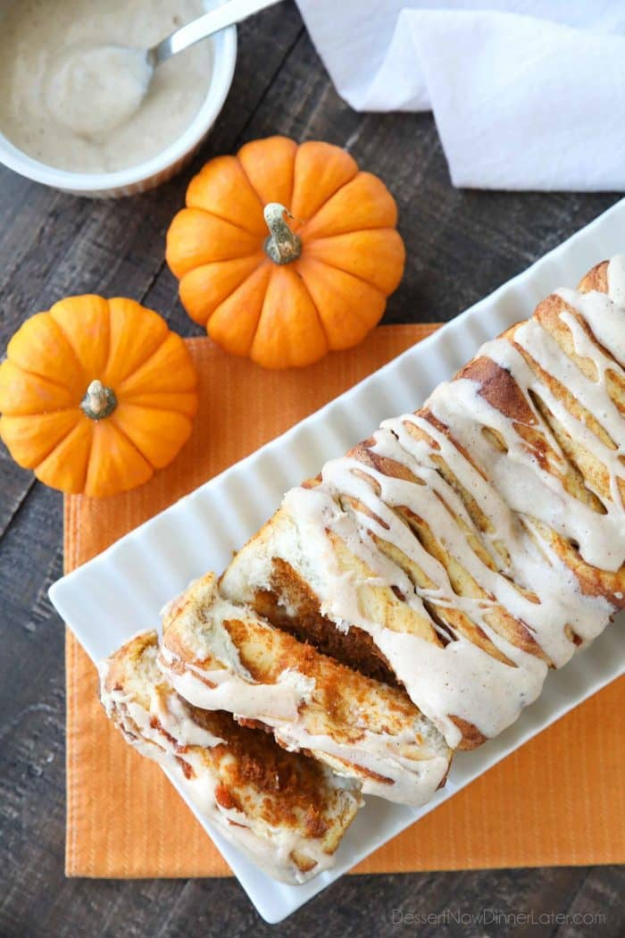 Pumpkin Pull Apart Bread is as delicious as sweet rolls, but super easy to make with layers of pumpkin, spices, and real store-bought yeast dough, not biscuits. Top it with a cream cheese glaze for a delicious seasonal breakfast or dessert.