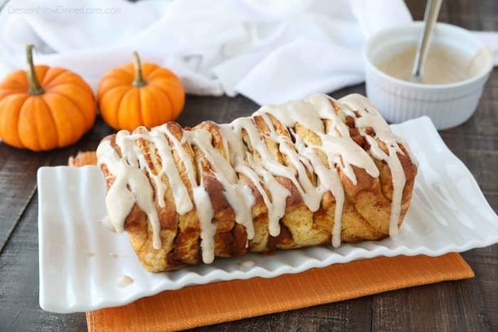 Pumpkin Pull Apart Bread is baked until golden brown and topped with a pumpkin spiced cream cheese glaze.