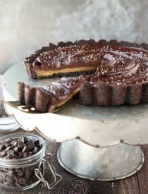 This easy Chocolate Caramel Tart has an Oreo cookie crust, soft caramel filling, and creamy chocolate ganache topped with flaky kosher salt. It's a rich and satisfying chocolate dessert that looks fancy, but is easy to make.
