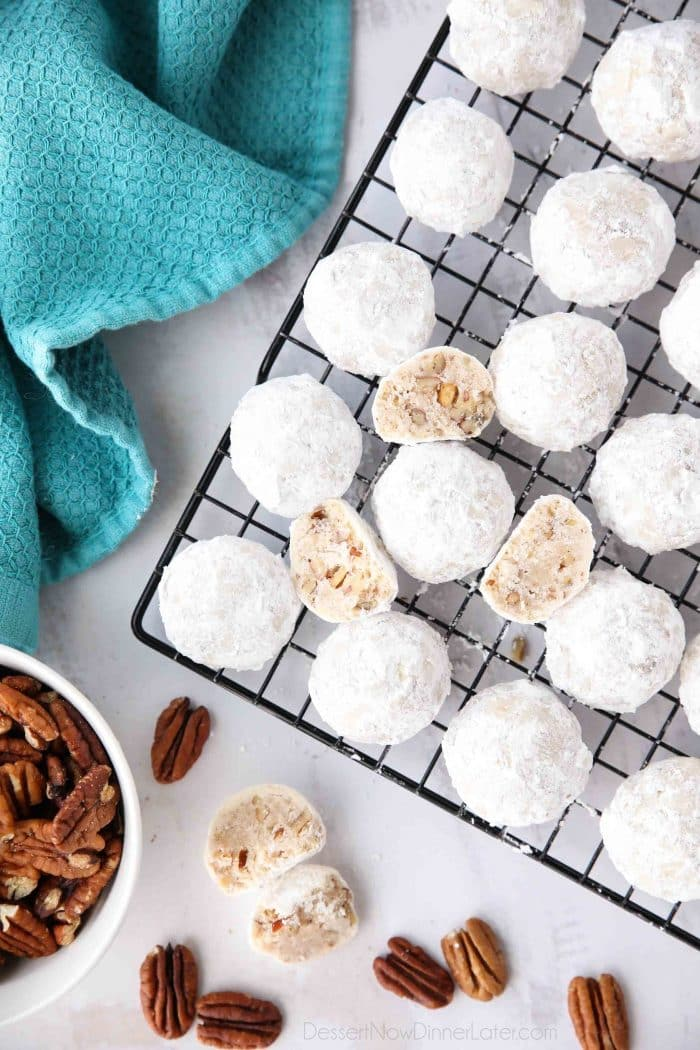 Snowball Cookies are round buttery shortbread cookies with chunks of pecans all rolled in powdered sugar. They melt in your mouth and are a delicious Christmas cookie.