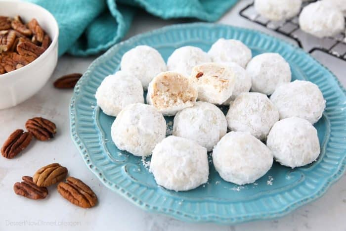 Snowball Cookies are round buttery shortbread cookies with chunks of pecans all rolled in powdered sugar. Other names for these cookies include Italian Wedding Cookies, Russian Tea Cakes, Mexican Wedding Cookies, or Southern Pecan Butterball Cookies.