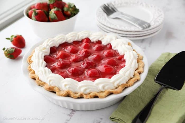 Strawberry Cream Pie is light, fruity, and delicious. With layers of pie crust, no-bake cheesecake, and slices of fresh strawberries smothered in a sweet glaze.