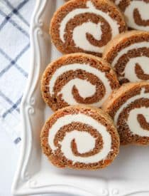This Carrot Cake Roll is a classic Easter dessert with a twist. Spiced carrot cake is rolled up with the best cream cheese frosting inside. It's beautiful, delicious, and easy to make.