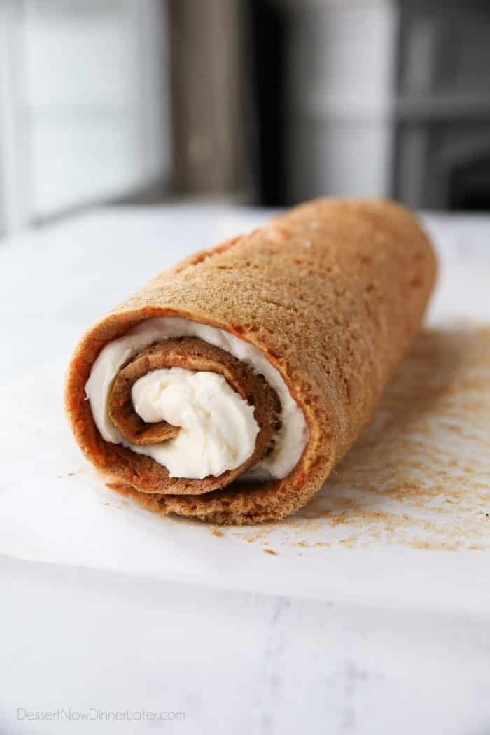 Cream cheese frosting rolled up inside of carrot cake.