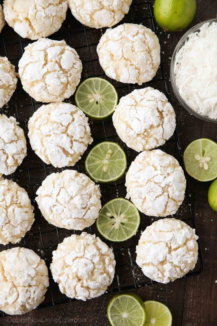 Powdered sugar coated crinkle cookies with key lime juice and zest and sweetened coconut flakes.