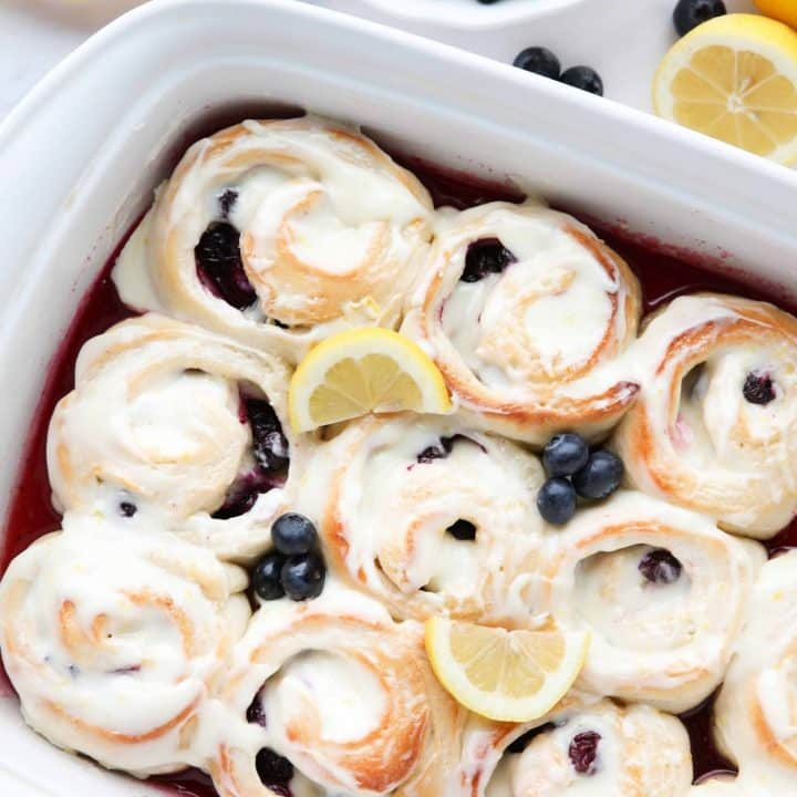 Lemon Blueberry Sweet Rolls are made easy with store-bought bread dough, a sticky lemon filling, fresh blueberries, and a tangy lemon cream cheese frosting.