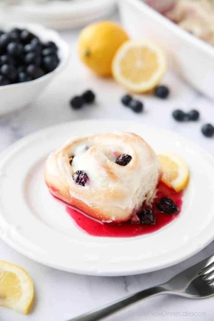 Lemon Blueberry Sweet Rolls are sweet and tangy with a gooey blueberry sauce, and zesty lemon cream cheese frosting.