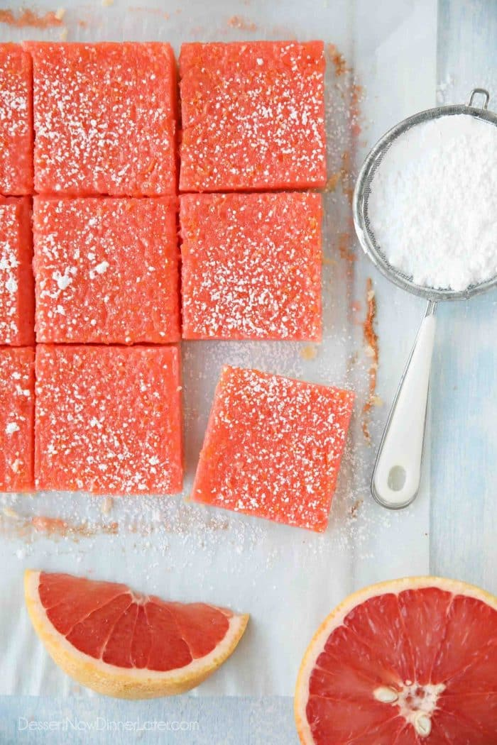 Grapefruit bars (just like lemon bars) cut into squares with a dusting of powdered sugar on top.