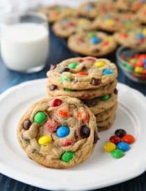 These bakery style M&M Cookies are loaded with chocolate chips and M&M candies. They're crispy on the edges, soft and chewy in the center, with plenty of chocolate throughout. The best M&M cookies! No chill time required -- just make and bake.