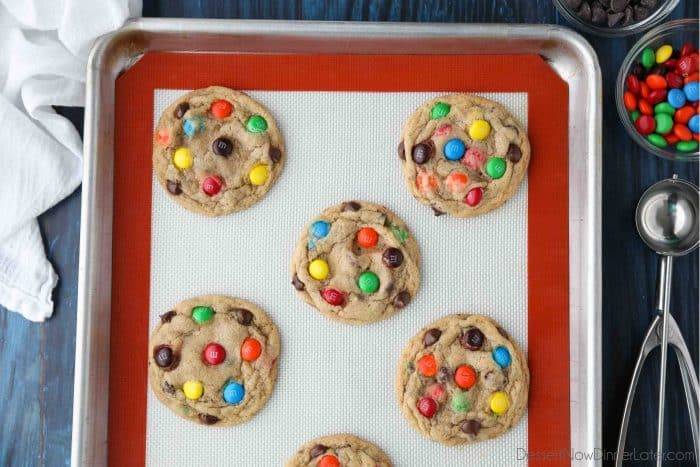 Freshly baked Chocolate Chip M&M Cookies on a sheet tray.