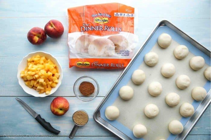 Ingredients for Peach Fritters Donut Recipe: Rhodes Rolls, Peaches, Cinnamon, Nutmeg, Brown Sugar.