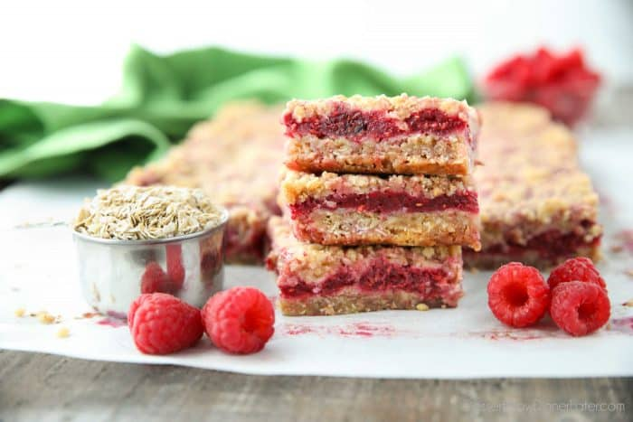 Three Raspberry Crumble Bars stacked on top of each other.