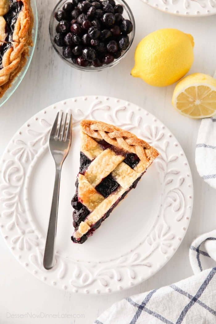 Slice of homemade blueberry pie made with frozen blueberries and a hint of lemon.