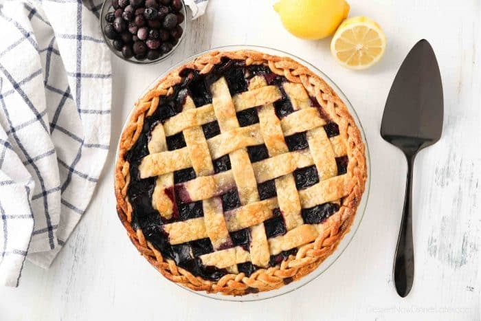 Whole blueberry pie with lattice crust and braided edges.