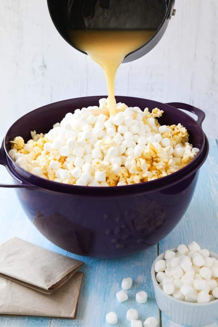Pouring the hot buttery syrup mixture over the popcorn will melt the mini marshmallows to create a soft and gooey marshmallow popcorn treat.