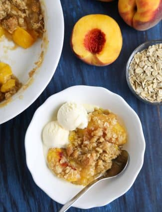 This easy peach crisp recipe (aka peach crumble) is loaded with fresh, juicy peaches topped with a generous helping of buttery brown sugar and oat streusel. Enjoy it with warm with a scoop of vanilla ice cream.