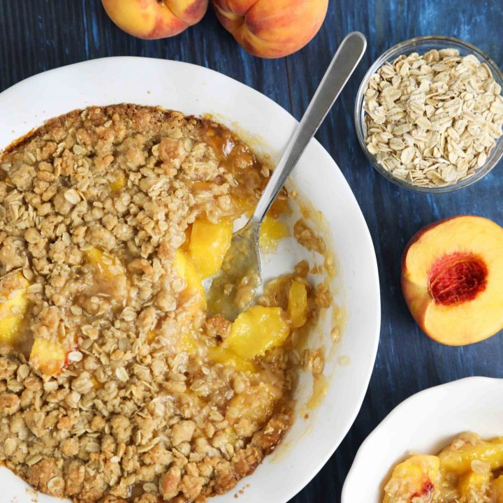 Fresh peach crisp made with a buttery brown sugar and cinnamon oat topping.