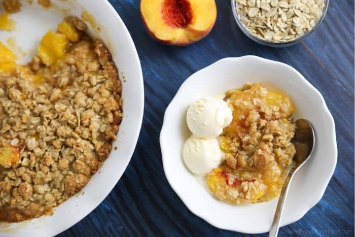 Peach Crisp - Fresh peaches simply sweetened, topped with a crunchy oat topping, and served warm with vanilla ice cream.