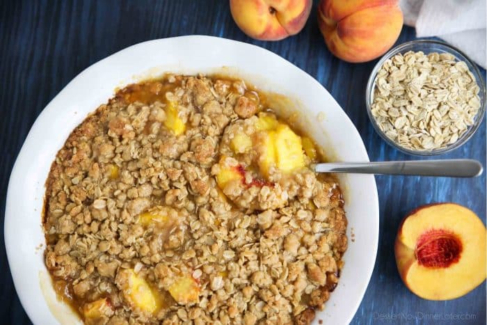 Peach Crisp (aka Peach Crumble) has saucy peaches and a crunchy streusel topping.