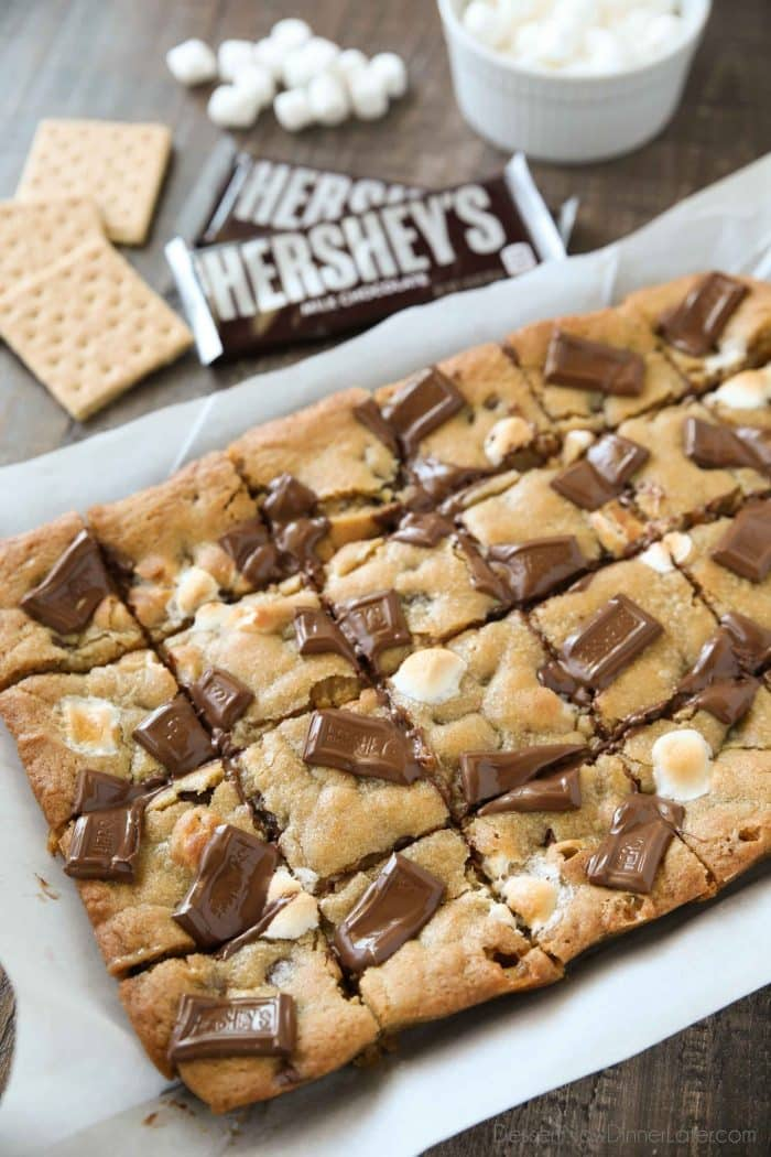 Chocolate chip cookie dough combines with a graham cracker crust, mini marshmallows, and chocolate pieces to make S'mores Cookie Bars.