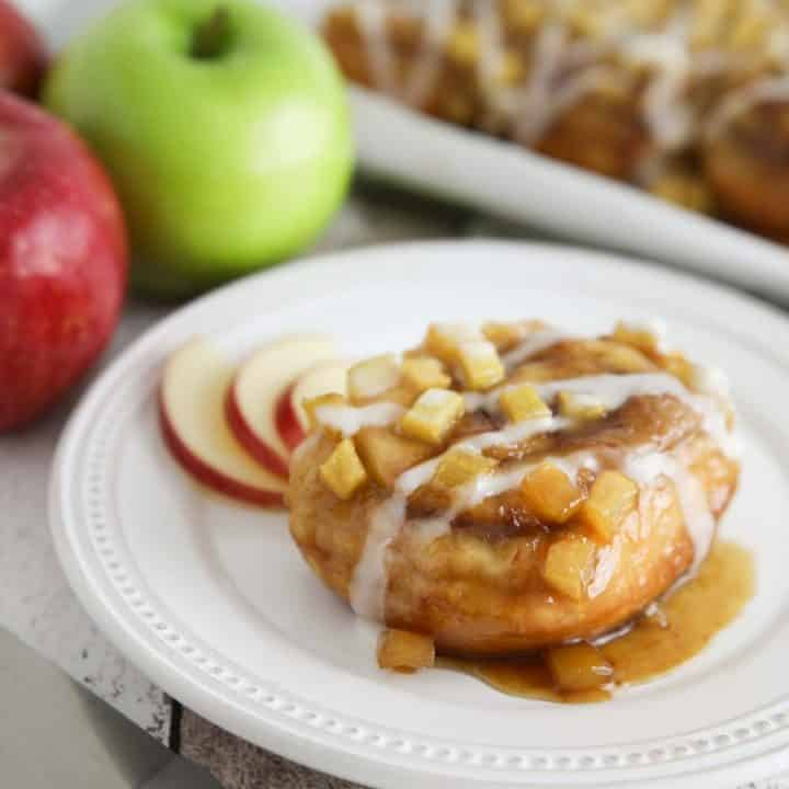 Caramel Apple Cinnamon Rolls are a twist on caramel pecan rolls, with fresh apples instead of nuts. They're made easy with frozen cinnamon rolls so half the work is done for you! A great breakfast or dessert in the Fall, on holidays, or the weekend.