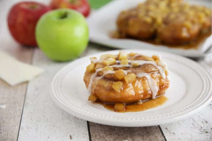 Sticky caramel apple cinnamon rolls are semi-homemade and 100% delicious. With fresh apples, and a quick caramel sauce baked in the oven.