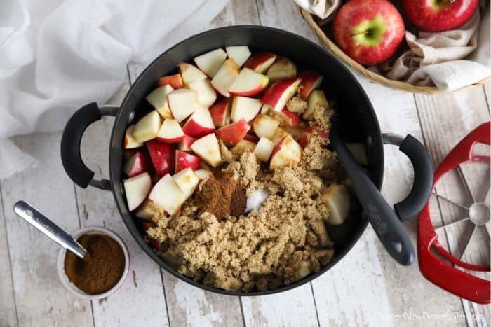 How to make apple butter: Place diced apples, brown sugar, cinnamon, cloves, salt, lemon and apple juice in a pot.