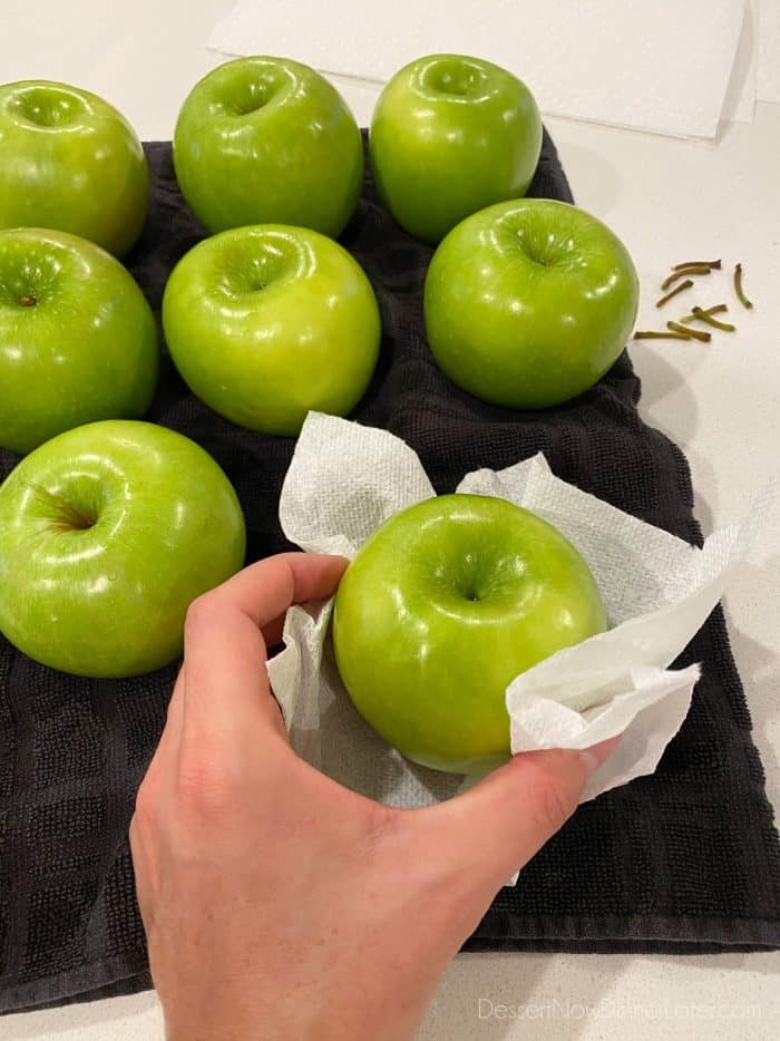 For caramel apples: Wash, rinse, and dry the apples completely. Remove stems before adding handles.