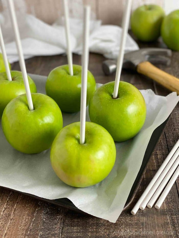 Use 6 to 8-inch Wilton cookie sticks for handles in the caramel apples. Gently tap into apple with a hammer or the flat end of a meat mallet.