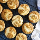 Pumpkin cream cheese muffins are light, fluffy, and moist, full of pumpkin spice flavor, and swirled with creamy cheesecake.