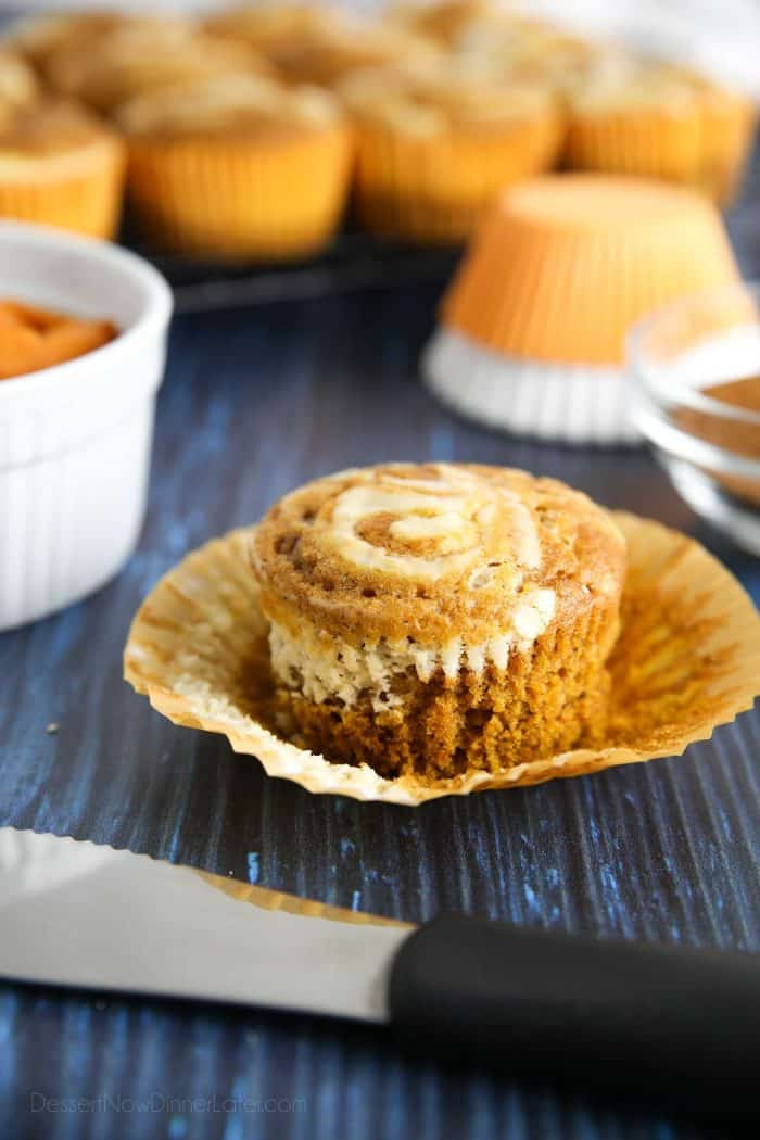 Moist pumpkin spiced muffins with a creamy cheesecake swirl on top.