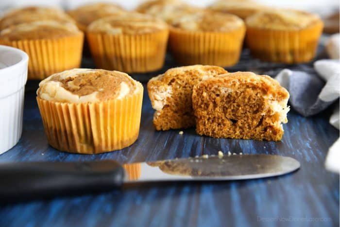 Fluffy and moist pumpkin spice muffins with cream cheese swirls.