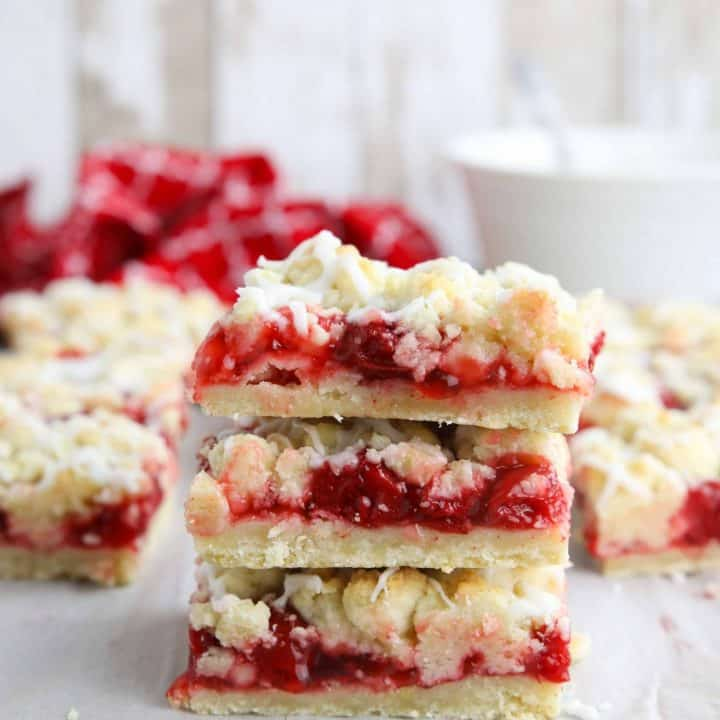 Three cherry pie bars stacked on top of each other.