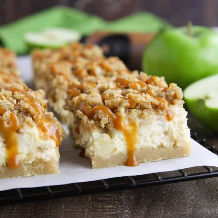 Close up of caramel apple cheesecake bars with caramel dripping down the side.