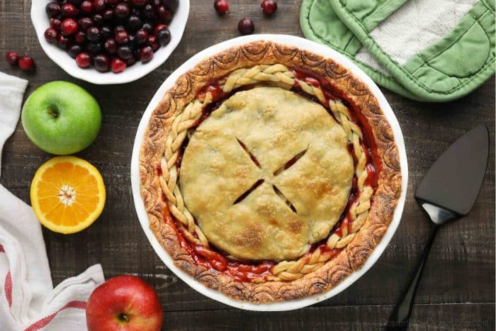 A whole apple cranberry pie with braided crust.