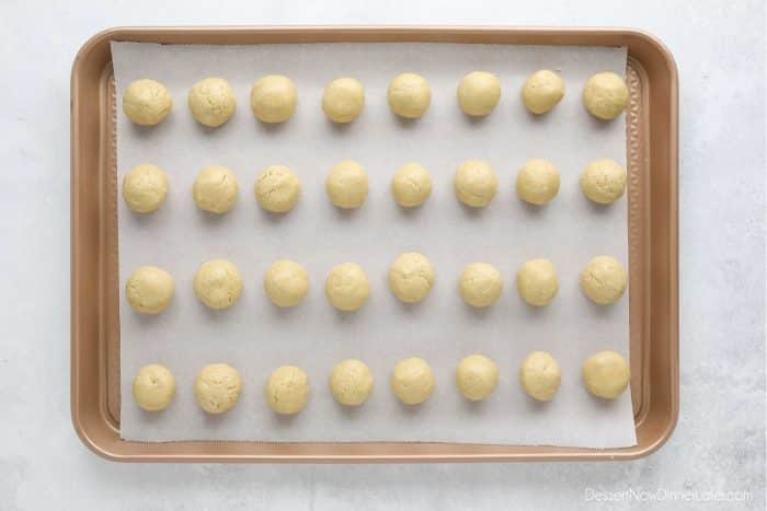 Peanut Butter Balls shaped on a tray, ready to be dipped in chocolate.