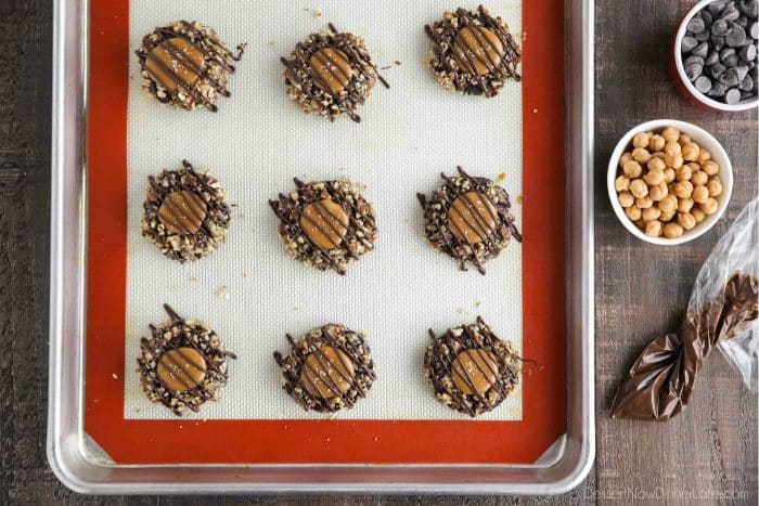 Finished turtle thumbprint cookies on sheet tray.