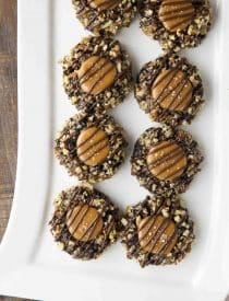 Turtle Thumbprint Cookies on long white rectangle platter.