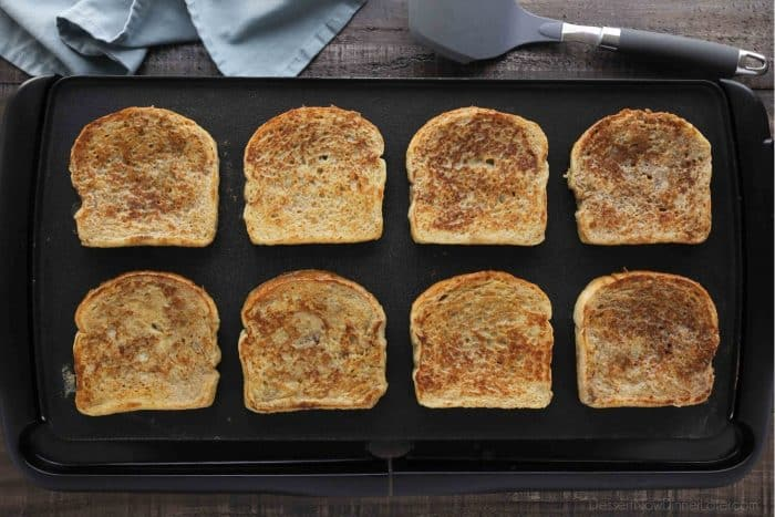 Classic French toast being cooked on a griddle.