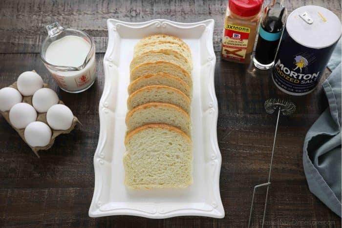 French Toast ingredients: eggs, milk, bread, cinnamon, vanilla, and salt.