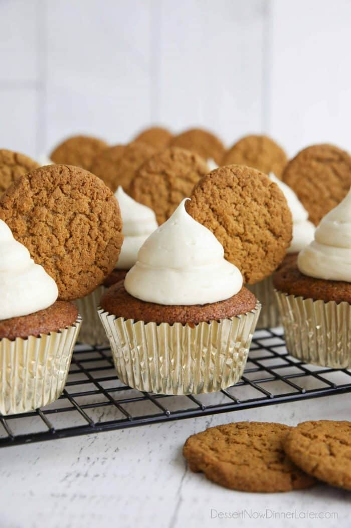 Gingerbread cupcakes with cream cheese frosting and a gingersnap cookies on top.