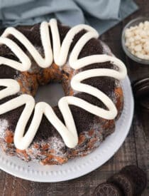 Angled view of Cookies and Cream Monkey Bread on a plate with zig-zagged cream cheese frosting on top.