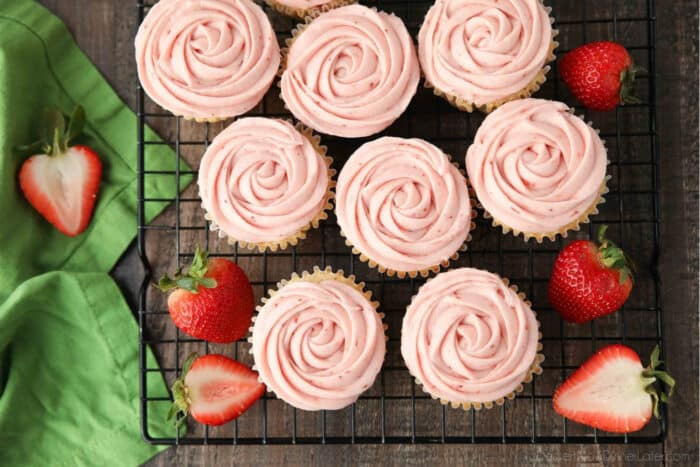 Rosettes piped onto fresh strawberry cupcakes.