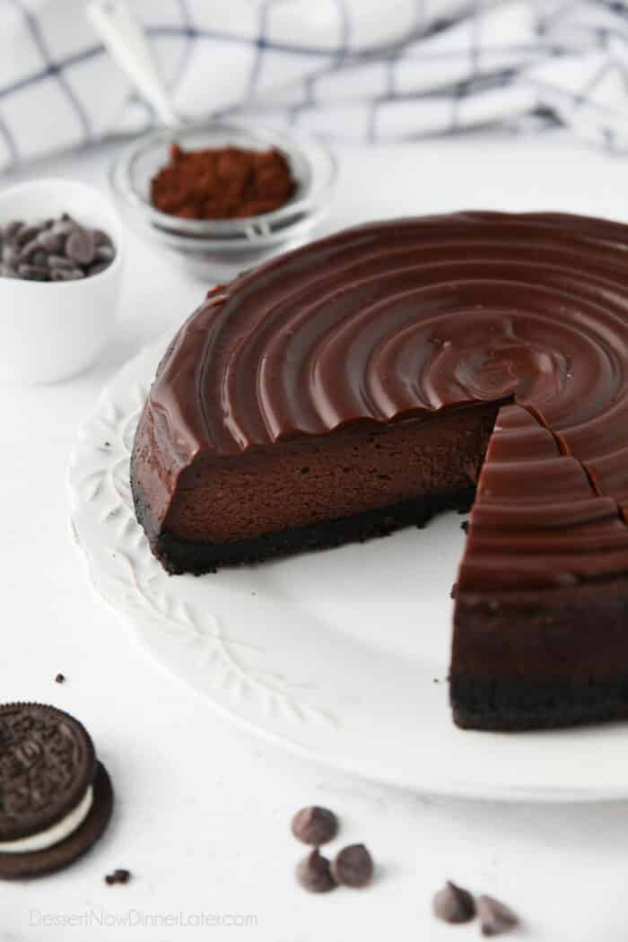 Triple Chocolate Cheesecake with slices taken out.