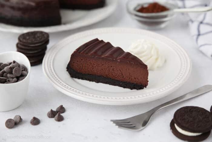 Triple Chocolate Cheesecake with an Oreo crust, cocoa powder cheesecake filling, and swirled chocolate ganache on top.