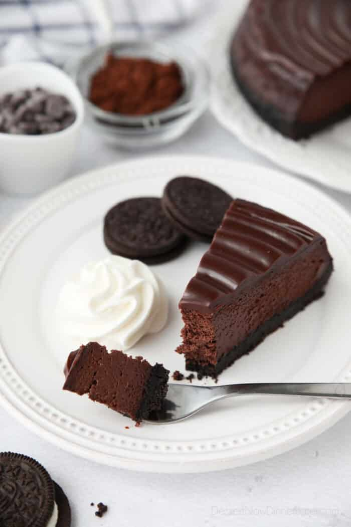 Triple Chocolate Cheesecake on a fork ready to be eaten.